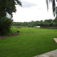 Vakantie Meerlo Onderwijzershuis uitzicht in de tuin